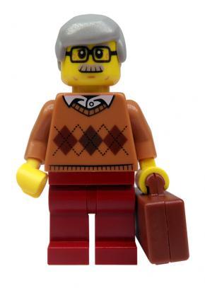 Lego mannetje met snor en koffer